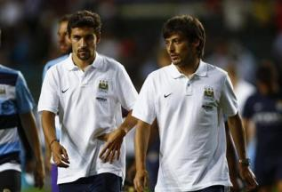 Manchester City players walk after watching their team play against South China at the Barclays Asia Trophy friendly soccer tournament in Hong Kong