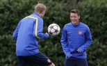 Arsenal's Mesut Ozil and Per Mertesacker attend a team training session at their training ground in London Colney