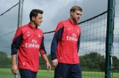 Per-Mertesacker-and-Mesut-Ozil-of-Arsenal-during-a-training-session-at-London-Colney-2268762