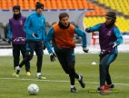 Real Madrid's Esteban Granero chases Xabi Alonso during a training session before their Champions League last 16 first leg soccer match against CSKA Moscow in Moscow
