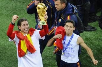 Spain's defender Sergio Ramos (L) raises