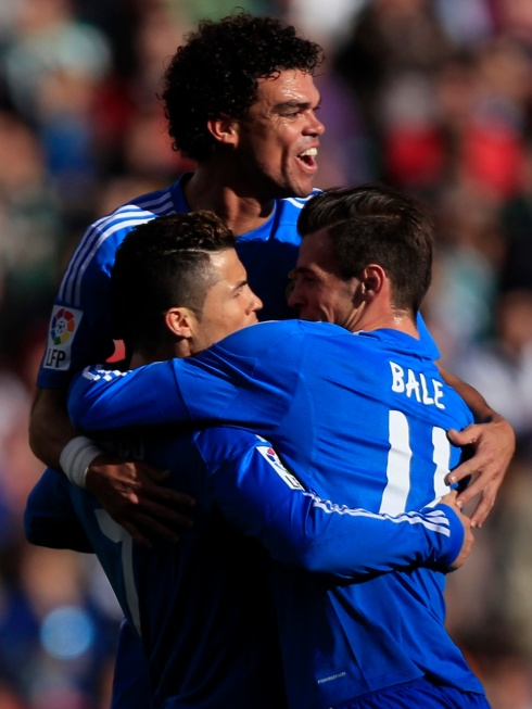 Real Madrid's Ronaldo is congratulated by teammates Bale and Pepe after scoring against Real Betis during their Spanish First Division soccer match at the Benito Villamarin stadium in Seville
