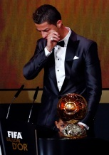 Portugal's Cristiano Ronaldo reacts with his son Cristiano Ronaldo Jr after being awarded the FIFA Ballon d'Or 2013 in Zurich