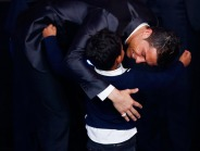 Portugal's Cristiano Ronaldo embraces his son Cristiano Ronaldo Jr after being awarded the FIFA Ballon d'Or 2013 in Zurich