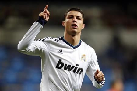 Real Madrid's Cristiano Ronaldo celebrates after scoring his second goal against Sevilla during their Spanish first division soccer match in Madrid