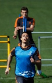 Real Madrid's Cristiano Ronaldo and Bale attend a training session at the Valdebebas training grounds, outside Madrid