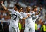 Real Madrid's Benzema celebrates with team mates after scoring a goal against Bayern Munich during Champion's League semi-final first leg soccer match in Madrid