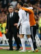 Real Madrid's Cristiano Ronaldo celebrates his second goal against Osasuna with teammate Fabio Coentrao in front of coach Carlo Ancelotti during their Spanish First Division soccer match at Santiago Bernabeu stadium in Madrid
