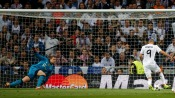Real Madrid's Karim Benzema scores past Bayern Munich's goalkeeper Manuel Neuer during their Champions League semi-final first leg soccer match at Santiago Bernabeu stadium in Madrid