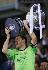 Real Madrid's goalkeeper Casillas lifts up the King's Cup trophy after defeating Barcelona in the King's Cup final at Mestalla stadium in Valencia