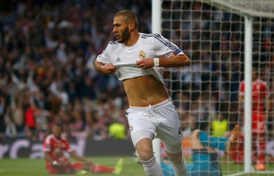 Real Madrid's Benzema celebrates after scoring a goal against Bayern Munich during Champion's League semi-final first leg soccer match in Madrid