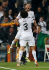 Real Madrid's Benzema celebrates with team mate Pepe after he scored agianst Bayern Munich during their Champions League semi-final first leg soccer match in Madrid