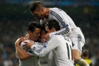 Real Madrid's Bale celebrates with teammates Bale and Ramos after scoring a goal against Borussia Dortmund during their Champions League quarter-final first leg soccer match at Santiago Bernabeu stadium in Madrid