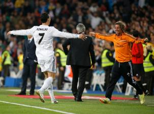 Real Madrid's Cristiano Ronaldo celebrates his second goal against Osasuna with teammate Fabio Coentrao during their Spanish First Division soccer match at Santiago Bernabeu stadium in Madrid
