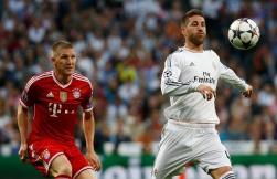 Real Madrid's Sergio Ramos controls the ball as Bayern Munich's Bastian Schweinsteiger waches during their Champions League semi-final first leg soccer match at Santiago Bernabeu stadium in Madrid