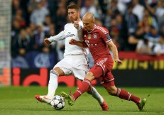 Real Madrid's Ramos challenges Bayern Munich's Robben during their Champions League semi-final first leg soccer match at Santiago Bernabeu stadium in Madrid