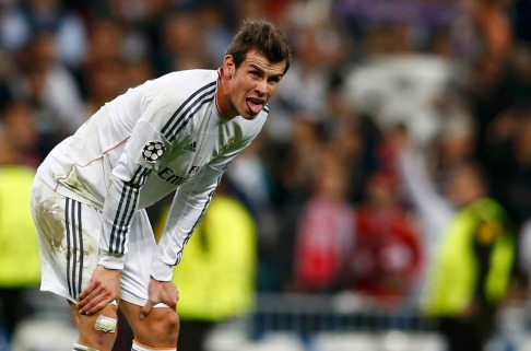 Real Madrid's sticks out his tongue during their Champion's League semi-final first leg soccer match against Bayern Munich in Madrid