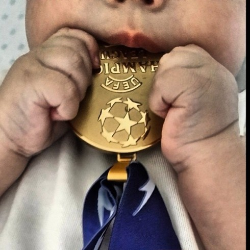 Martin uses his papi's gold medal as a teething ring.