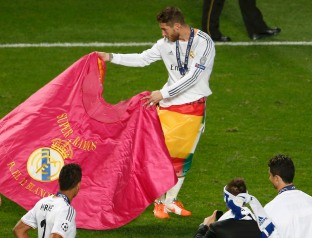 Real Madrid's Ramos performs a bull fight as he celebrates after defeating Atletico Madrid in their Champions League final soccer match at the Luz Stadium in Lisbon