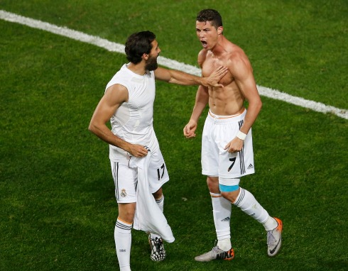 Real Madrid's Ronaldo celebrates with his team mate Arbeloa after scoring a goal against Atletico Madrid during their Champions League final soccer match at the Luz Stadium in Lisbon
