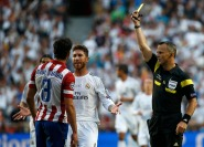 Atletico Madrid's Garcia receives a yellow card by referee Kulpers as Real Madrid's Ramos complains during their Champions League final soccer match at the Luz stadium in Lisbon