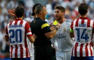 Real Madrid's Ramos argues with referee Kulpers during Real Madrid's Champions League final soccer match against Atletico Madrid at the Luz stadium in Lisbon