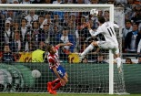 Real Madrid's Bale shoots and scores the second goal for the team during their Champions League final soccer match against Atletico Madrid at the Luz Stadium in Lisbon
