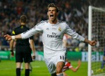 Real Madrid's Bale celebrates after scoring a goal against Atletico Madrid during their Champions League final soccer match at the Luz Stadium in Lisbon