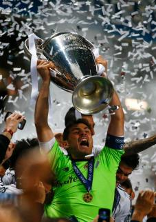 Real Madrid's captain Casillas celebrates with the trophy after defeating Atletico Madrid in their Champions League final soccer match at the Luz Stadium in Lisbon
