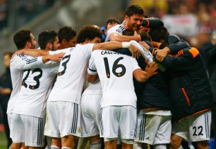 Real Madrid's Alonso celebrates with team mates their fourth goal against Bayern Munich during their Champions League semi-final second leg soccer match in Munich