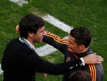 Real Madrid's Ronaldo embraces former Real Madrid's captain Raul before a training session ahead of their Champions League soccer final at Luz stadium in Lisbon