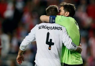 Real Madrid's Ramos embraces goalkeeper Casillas celebrate after the end of the regular time during their Champions League final soccer match at the Luz stadium in Lisbon