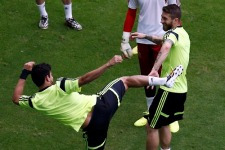 Spain's Costa kicks teammate Ramos during a training session at the Arena Fonte Nova stadium in Salvador