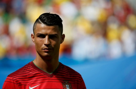 Portugal's Cristiano Ronaldo looks on before the start of their 2014 World Cup Group G soccer match against Ghana at the Brasilia national stadium in Brasilia