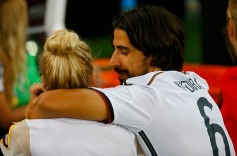 Germany's Khedira shares a moment with his girlfriend Gercke as they celebrate his team winning the World Cup trophy at the end of their 2014 World Cup final against Argentina at the Maracana stadium in Rio de Janeiro