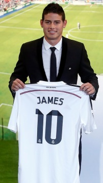 Colombia's soccer player James Rodriguez holds up his new Real Madrid jersey during a presentation at the Santiago Bernabeu stadium in Madrid