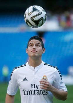 Colombia's soccer player James Rodriguez controls the ball during his presentation at the Santiago Bernabeu stadium in Madrid