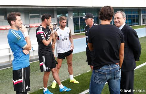 """""""Okay everyone, chuckle warmly for the cameras. Except you, Carlo, you can look stern."""""""
