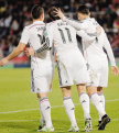 Bale sneaks in between James and Cris