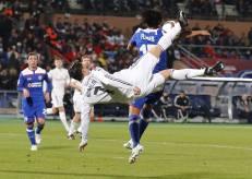 Cris attempts an overhead kick