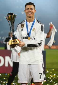 Cris holds the trophy
