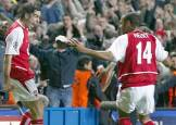 French connection- Pires and Thierry Henry celebrate Arsenal's vital away goal