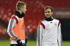 hi-res-450384623-marco-reus-and-mario-goetze-of-germany-warm-up-during-a_crop_exact