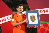 Iker holds a FIFA plaque