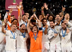 Iker lifts the trophy