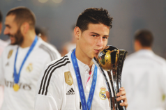James kissing the trophy