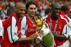 March 2002- Thierry Henry, Robert Pires and Sol Campbell of Arsenal celebrate winning the league at Highbury against Everton