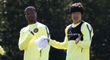 Manchester United's Park gestures as he stands with Evra during a training session at the club's Carrington training complex in Manchester