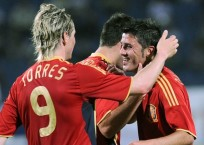 Villa of Spain is congratulated by team mates Torres and Marchena after scoring against Azerbaijan during their friendly soccer match in Baku