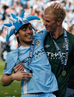 Manchester City's Silva and Hart celebrate winning the English Premier League following their soccer match against Queens Park Rangers in Manchester